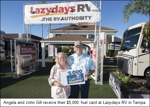 Angela and John Gill receive their $5,000 fuel card at Lazydays RV in Tampa